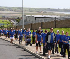 Employees take part in a 10K run